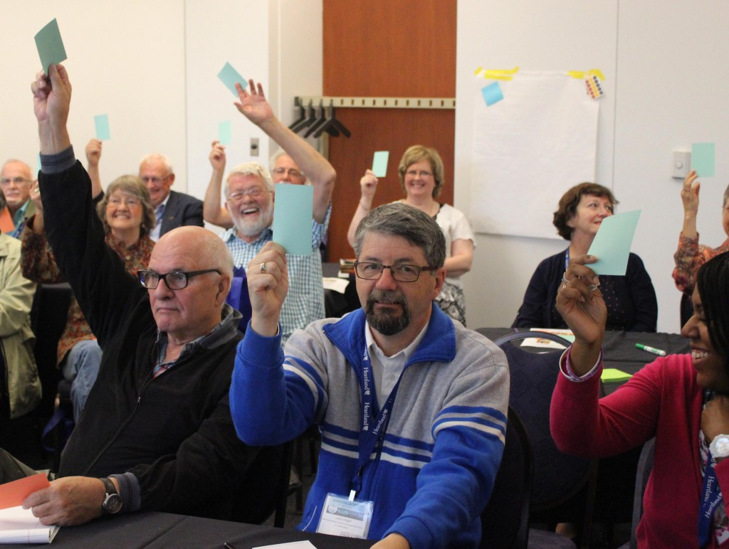 Participants at the North American Interfaith Network conference in Detroit help out on the upcoming Bias Busters project in Muslim Americans.