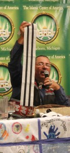 Myeengun Henry, manager of Aboriginal Services at Conestoga College Institute of Technology and Advanced Learning in Kitchener, Ontario, shows a wampum treaty belt that pledge non-interference among settlers and indigenous people.