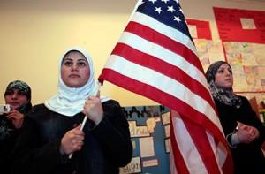 Muslim woman holds American flag
