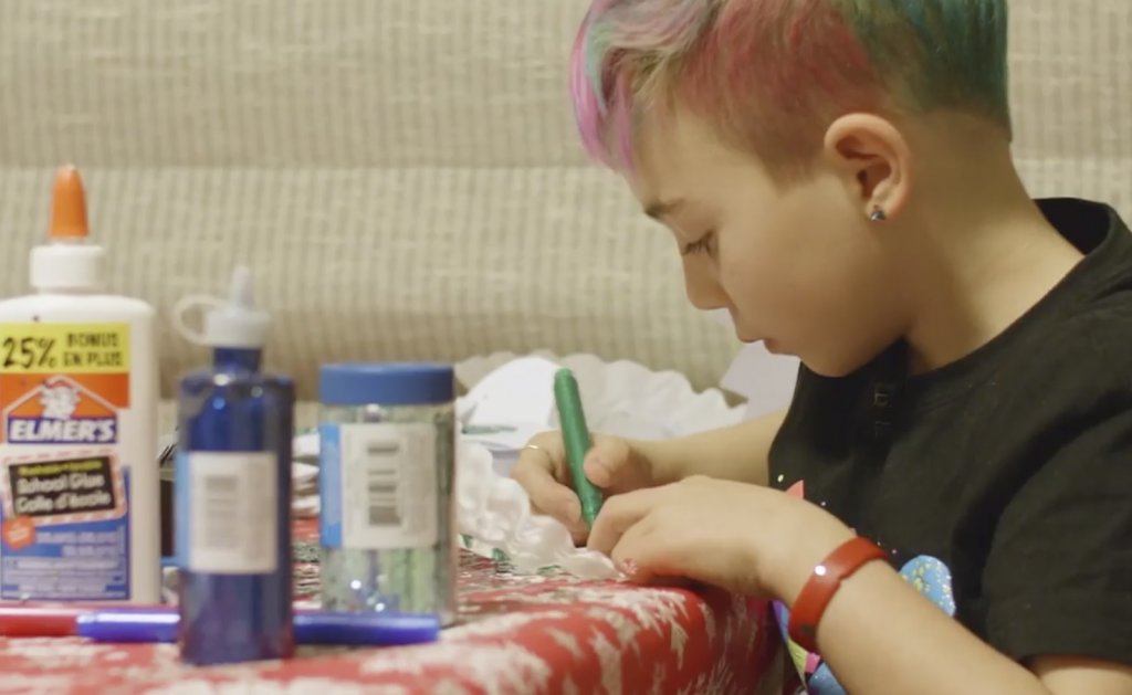 7-year-old working at a table on an art project