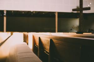 Silhouette of cross in empty church