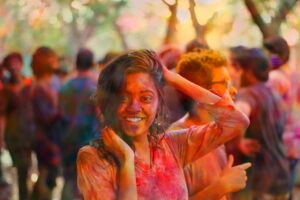 People celebrate Holi with colorful dyes
