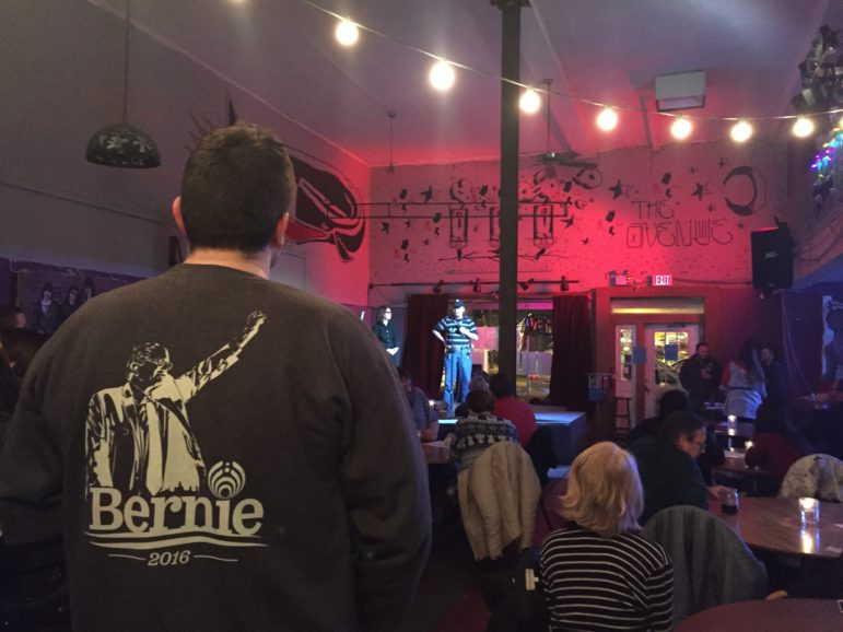 MSU medical student James Conwell listens to a Bernie Sanders supporter at The Avenue Cafe. Photo by: