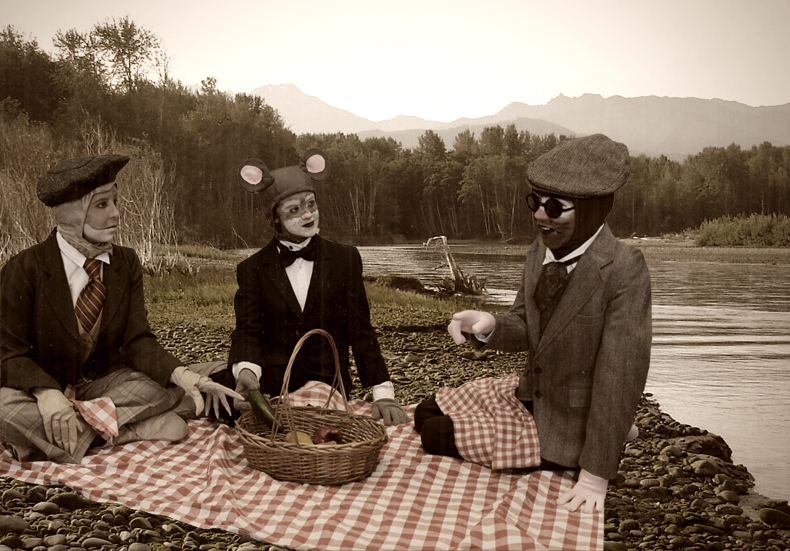 Toad (Morgan Pohl), Rat (Ava Brewer) and Mole (Emma Stroupe) picnic by the river- the Rat's favorite place-with the Wild Wood in the distance.