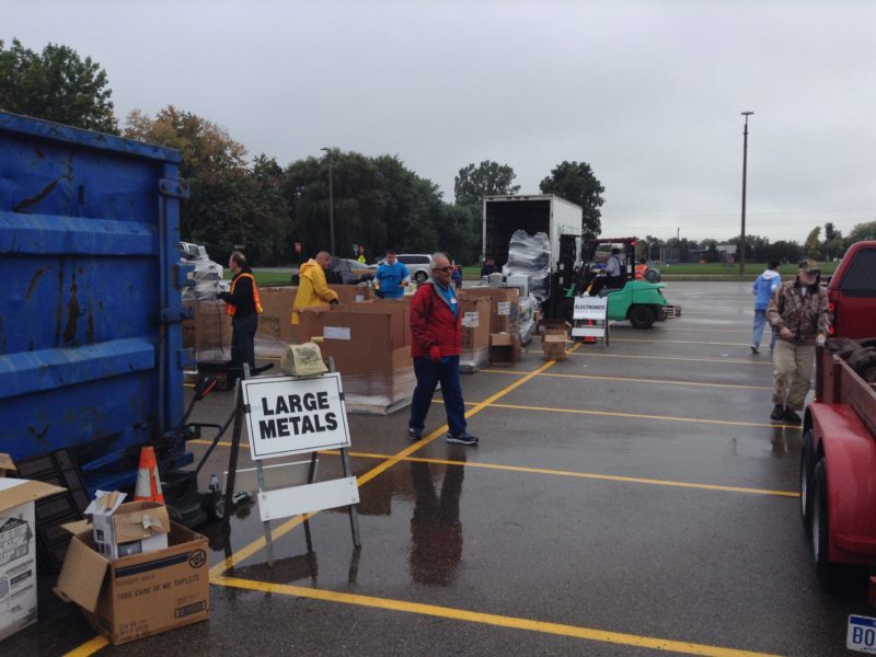 """The """"Large Metals"""" and """"Electronics"""" sections battle the rain to collect people's unwanted goods at the Meridian Recycling event. (Photo Credit: Michael Epps)"""