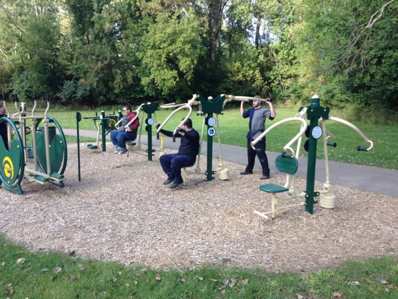 "Members of the community work out at the new ""Fitness Zone"" at Wonch Park."