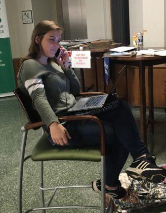 Through her internship with the Clinton campaign, Rachel Cichon, a second-year political science student at Michigan State University, is getting students registered to vote at the MSU Union on Oct. 3.