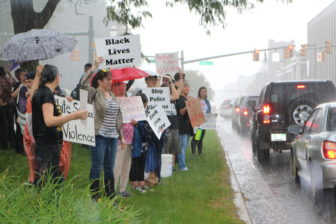 Rally attendees endured heavy rainfall to spread their message