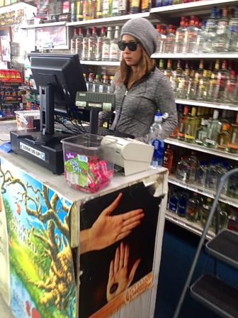 Cashier Jane Ames at Spartan Spirits party store.