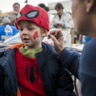 East Lansing resident Ray Stiles, 4, has his face painted during the 9th annual Trick-or-Treat on the Square on Oct. 24, 2016, along Washington Square in Lansing.