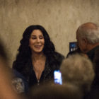 Singer and actress Cher smiles as she makes her way to exit the Union Ballroom on Oct. 31, 2016, at the MSU Union. Cher spoke in favor of Democratic candidate Hillary Clinton and drilled the importance of voting for a candidate that will benefit Americans.