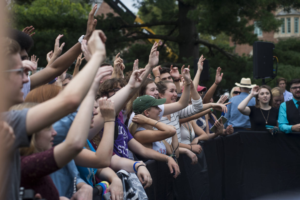 People cheer while a band plays before Sen. Bernie Sanders' appearance on Oct. 6, 2016 at Adams Field.