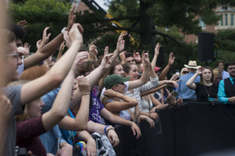 People cheer while a band plays before Sen. Bernie Sanders' (I-Vt.) appearance on Oct. 6, 2016 at Adams Field. East Lansing is one of four locations that Sanders campaigned at on Thursday.