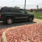 James G.'s vehicle waits in a handicapped spot while he votes in the presidential election thanks to curbside voting.