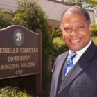 Milton Scales serves as a Meridian Township trustee.
