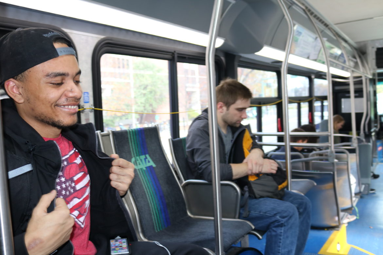 MSU freshman Sam Bryant talks to Sajjad Abdul while riding the CATA bus.