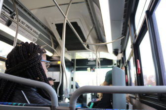 MSU junior Cha'Kiara Payne rides the CATA bus to her polling location to vote in the 2016 presidential election.