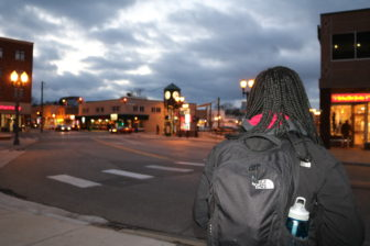 MSU sophomore Beth Herbert waits for her bus in downtown East Lansing