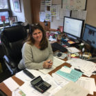 Michigan State University athletics compliance director Jen Smith sits at her desk in Jenison Fieldhouse.