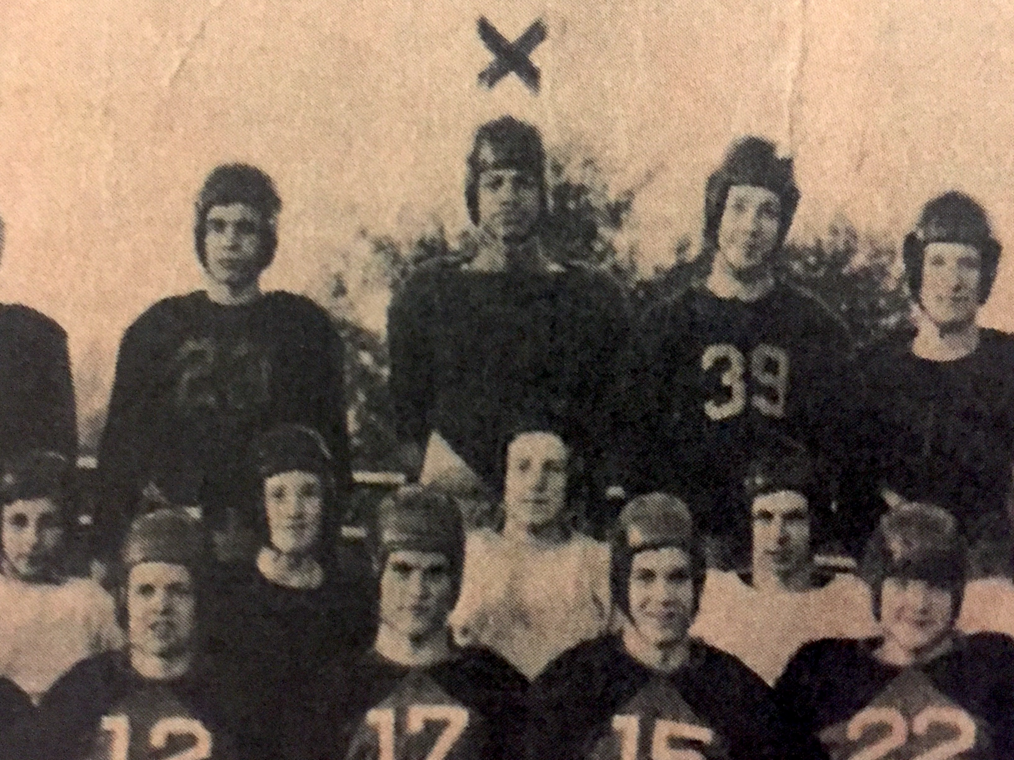 """Malcolm X seen below the """"X"""" in a football team picture at Mason High School, where he also played basketball and was elected class president."""