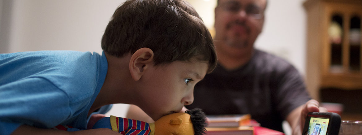 Shay Quintanilla, 3, watches an educational video as part of his pre-kindergarten homeschooling. His dad, Domingo Quintanilla stays at home with him and his brother while his wife is at work.