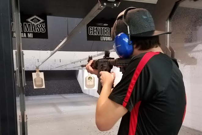 22-year-old WMU student Colin Sytsma shoots his AR-15 rifle.