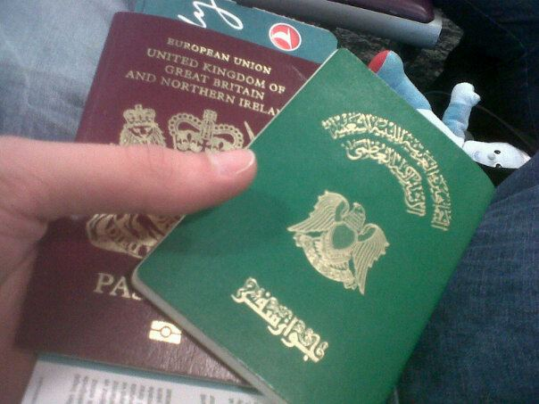 Libyan and U.K. passports. Photo by M.O.G.G.Z. Licensed under Creative Commons Attribution-NonCommercial-NoDerivs 2.0 Generic