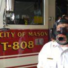 A man wearing an oxygen mask.