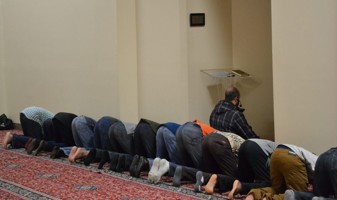 Members of the East Lansing Islamic community gather at the local Islamic Center, located on South Harrison Road, for evening prayer.