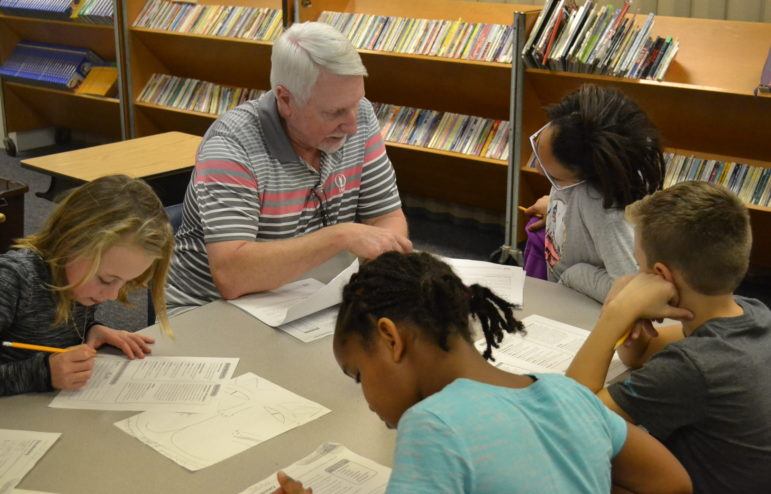 Marble Elementary School teacher meets in a small group with students to help with classwork