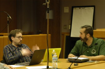 Vice Chairperson Jonathan Irvin discusses the new website with IT Director Thomas Crane.