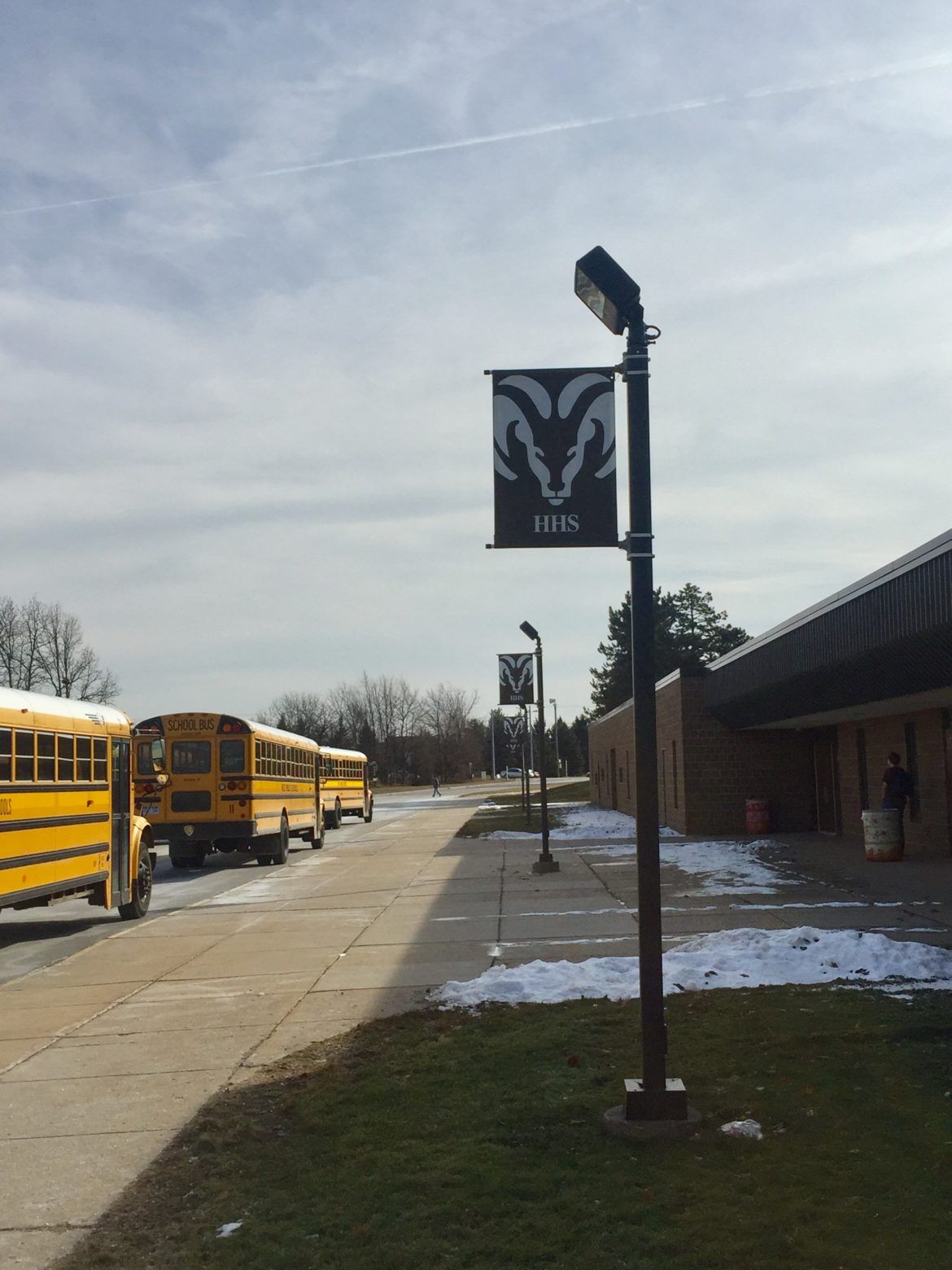 Buses line the side parking lot of the Holt North High school campus on Feb. 10, 2017. The buses have to pick up the students at the North Campus before the students at the Main campus because of the slight schedule difference.
