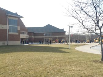 Students walk out of the Holt High school main campus on Feb. 10, 2017. It is possible for senior students to have classes between the two buildings, so there is normal traffic back and forth across the road between the two buildings on a daily basis.