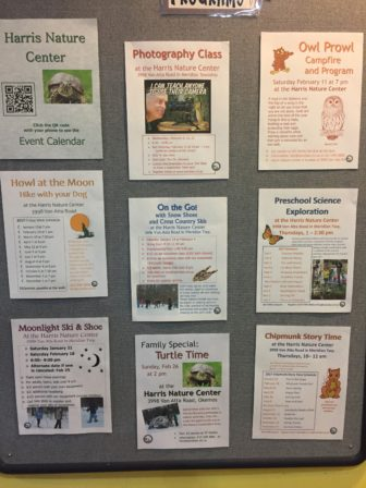 Harris Nature Center bulletin board advertising events.