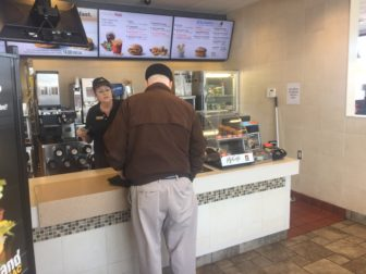 Melinda Hull takes a customers order at McDonald's in Williamston.