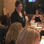Michigan Supreme Court attorney Kimberly Muschong led a huddle meeting in Mason, Michigan Monday night at a local brewery.