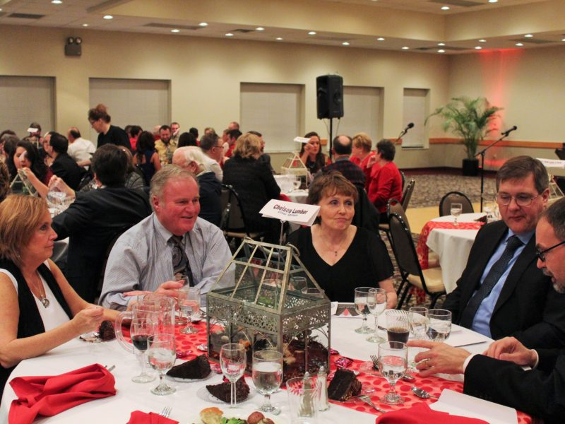 Attendees of last year's Red Tie Affair gathering at the Banquet and Conference Center of Dewitt. Courtesy of Loretta Spinrad.