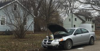 A silver Dodge Stratus sedan owned by Devon Williams, 28, of Lansing, Mich. in front of 642 Mifflin Ave. Williams said shoddy infrastructure is the reason his car is missing parts of the front bumper. Photo by Casey Harrison.