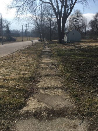 A stretch of sidewalk at the 500 block of Charles St. in Lansing Township, Mich. According to the 2015-2024 Comprehensive Sidewalk Plan, Charles St. is not scheduled for renovations. Photo by Casey Harrison.