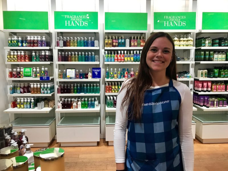 Bath & Body Works employee, Abby Ciesalk poses for a photo as she discusses her employment experience in Lansing Township. Photo by Hannah Holliday.