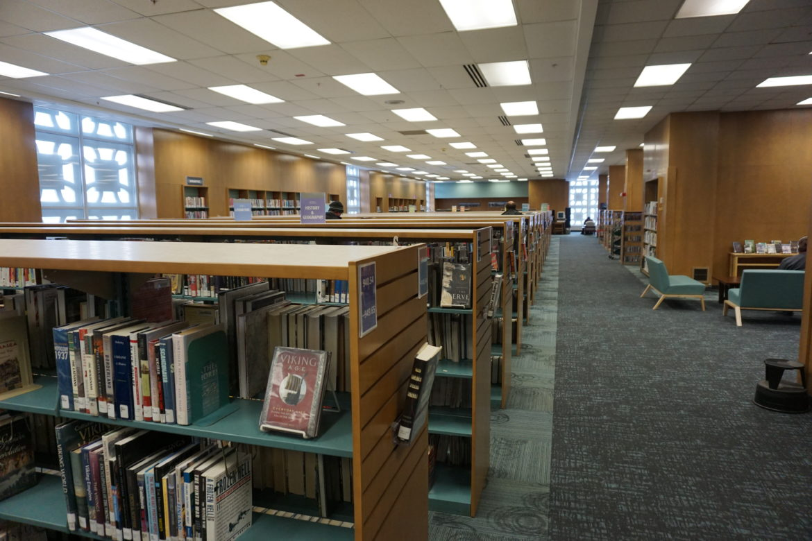 Shorter shelves help make the renovated Downtown Lansing branch feel more open. Photo by Lukas Eddy
