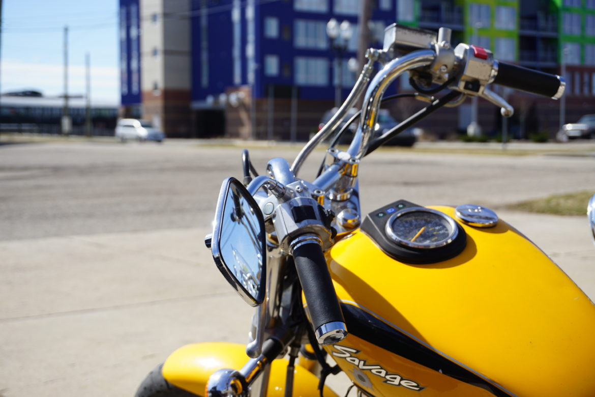 A motorcycle sits in the College Bike Shop parking lot. Photo by Lukas Eddy