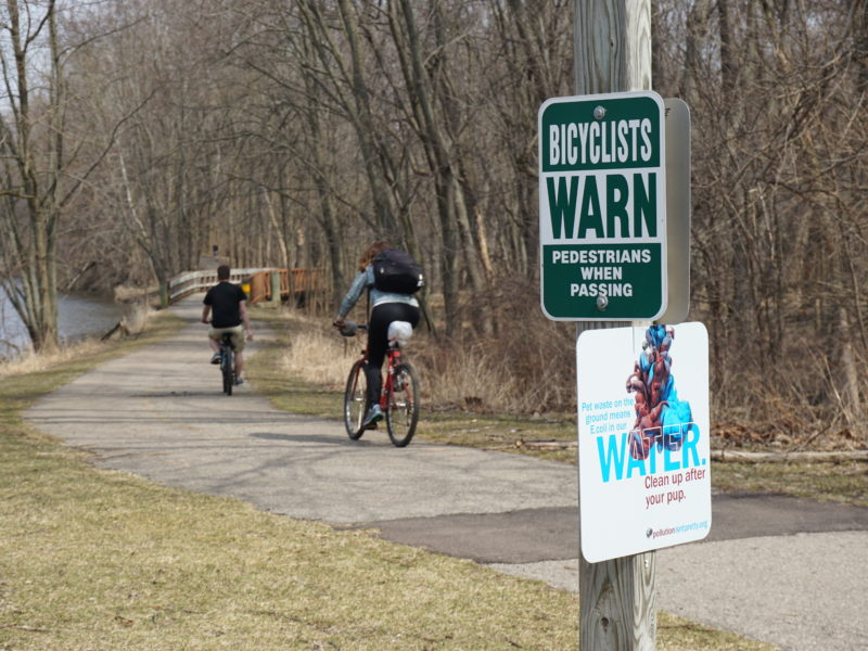 More bicyclists ride on the Lansing River Trail. Photo by Lukas Eddy