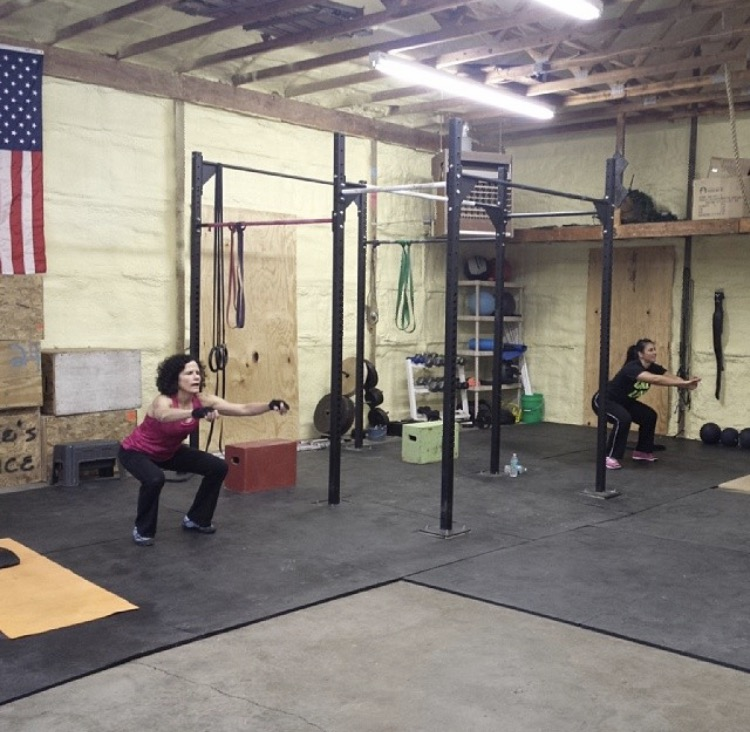 Members of T5 CrossFit gym in Holt doing exercise moves on March 28.
