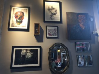 A look at the inside walls of The Creole. Robert Busby's self portrait pictured on the right. Photo taken by Alexis Downie.