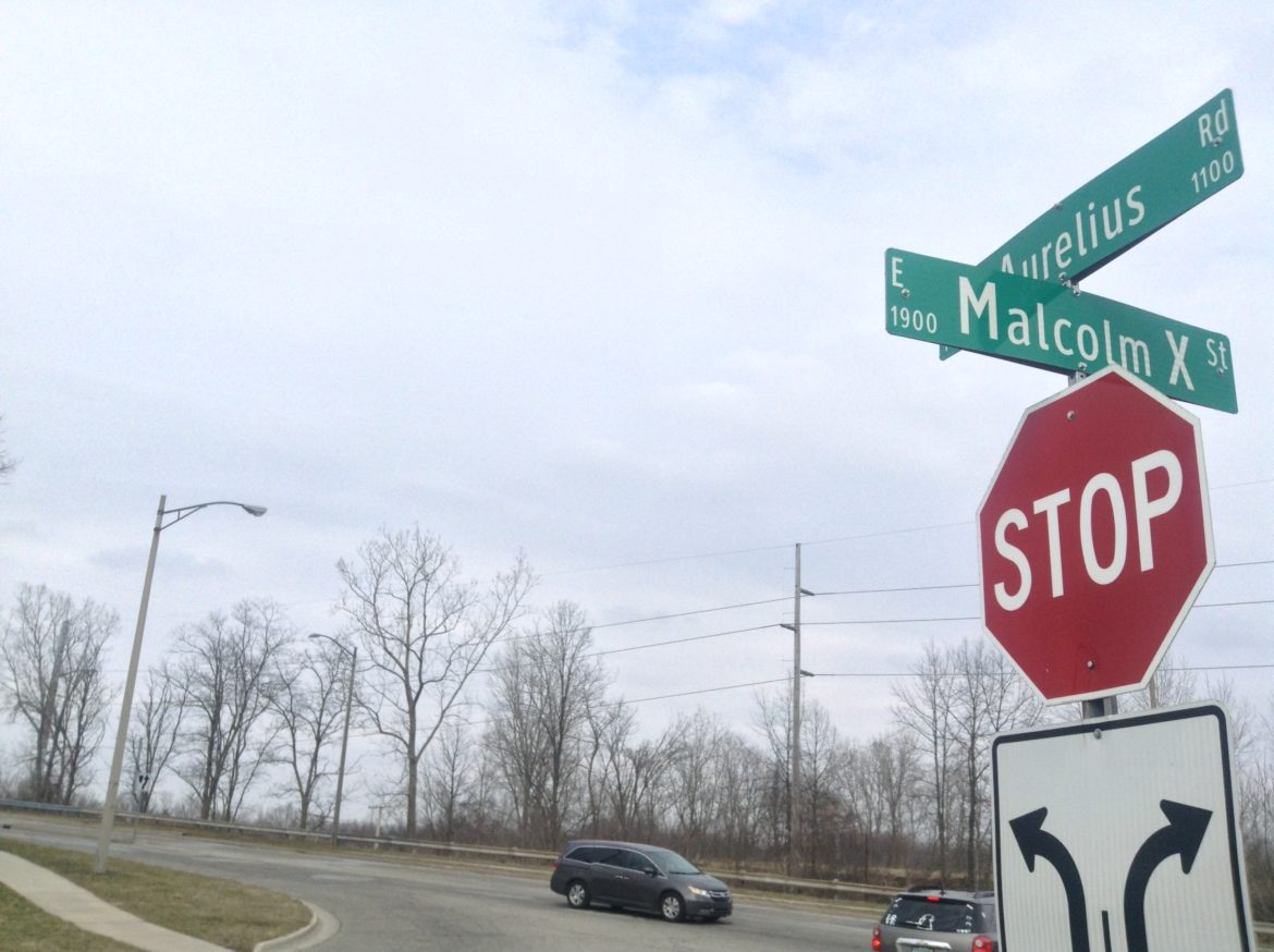 A street sign marking Malcolm X Street in Lansing. Its intersection with Aurelius Road is its eastern terminus. Photo by Maxwell Evans