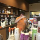 Antonio Baker prepares an iced coffee drink for a customer at Biggby Coffee in Lansing Township. Photo by Hannah Holliday.