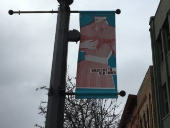 A banner hanging on a lamp post welcomes visitors to Old Town. Photo by Kaley Fech.