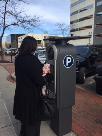 Mrs. L. Vinson paying at a new pay by plate meter in downtown Lansing.