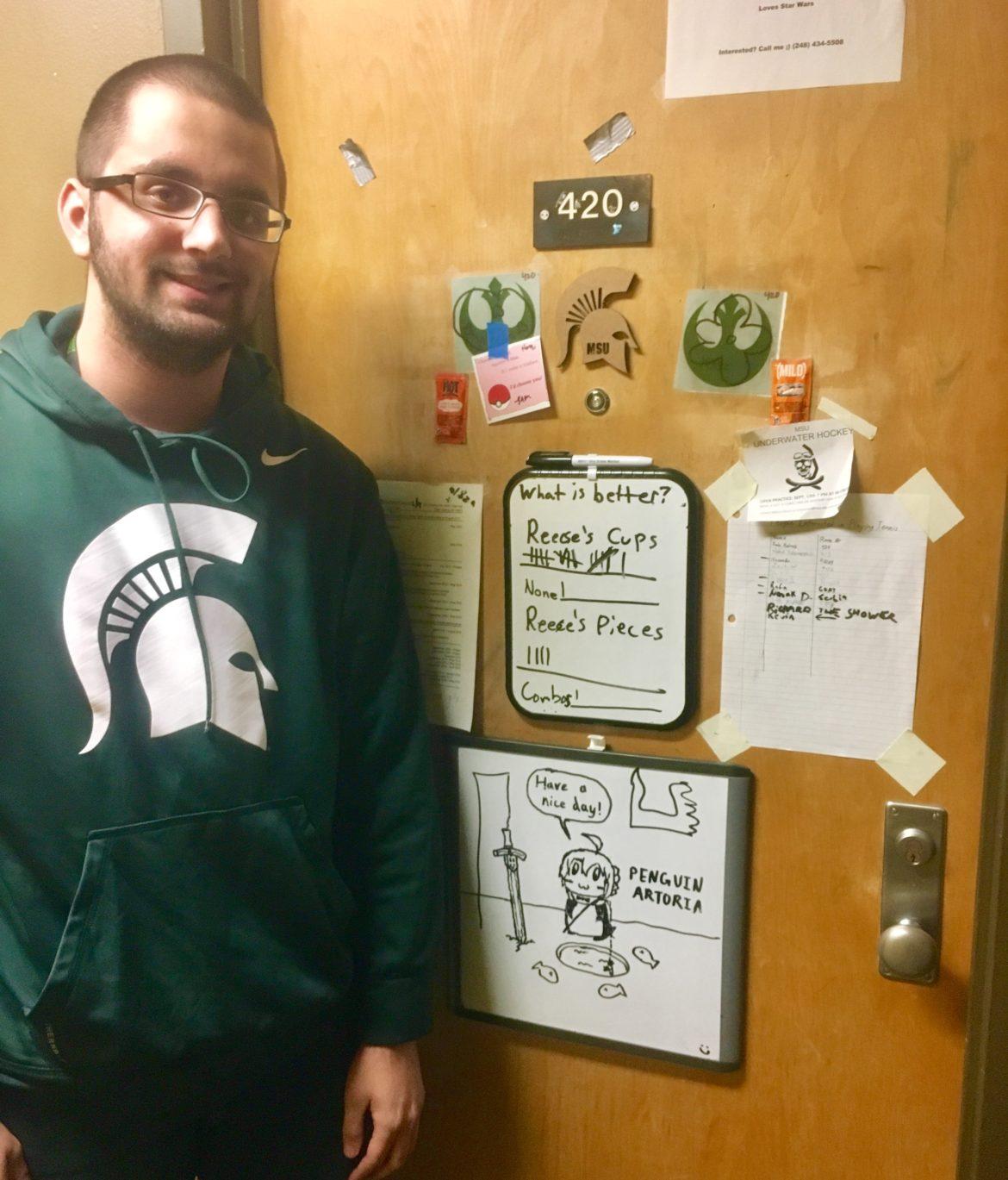 Kade Katrak shows off his whiteboards